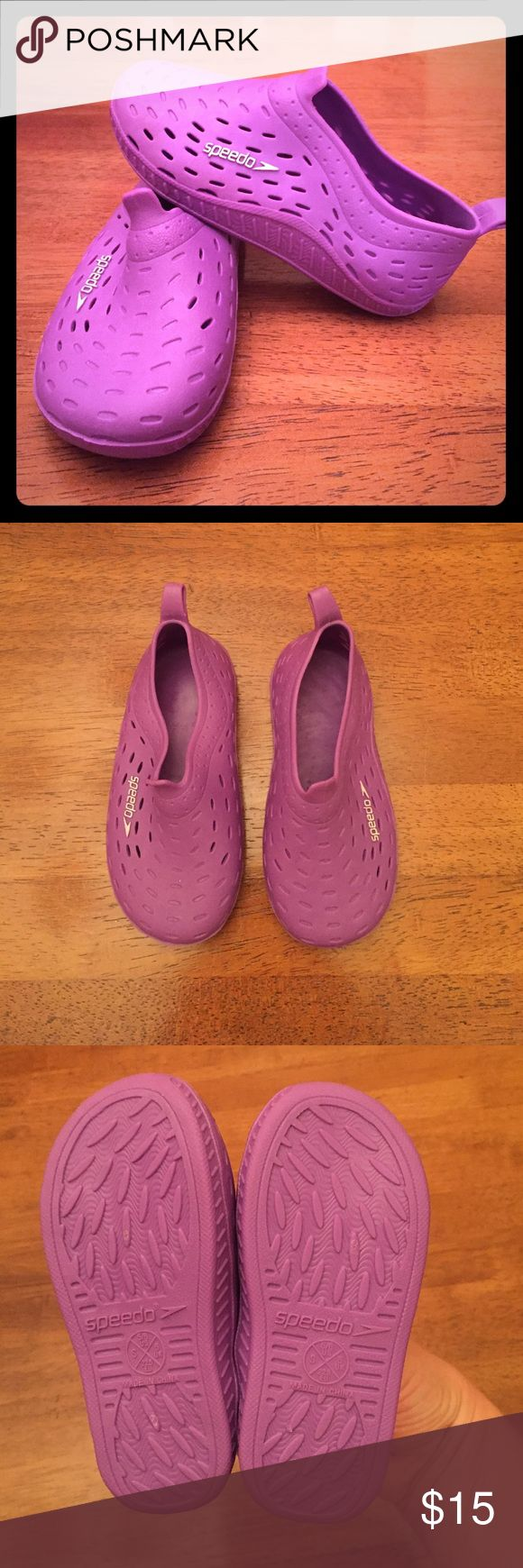NWOT Speedo girl's water shoes in PURPLE! SPEEDO water shoes in purple. Never worn! Too big for my little when we bought them this summer. No tags, but in perfect condition! White emblem with breathable rubber and back pulls so they slide on easily. size SMALL 5/6. Speedo Shoes Water Shoes
