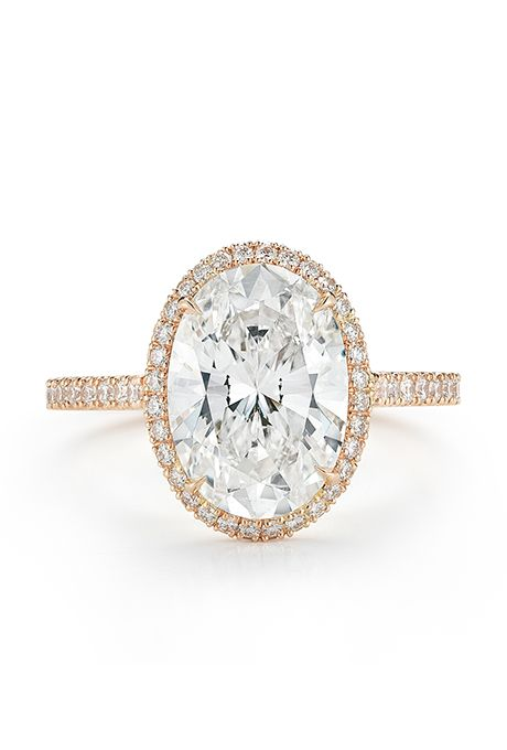 Brides: Kwiat. Oval diamond engagement ring three-carat oval center stone with diamond frame in 18k rose gold, price upon request, Kwiat