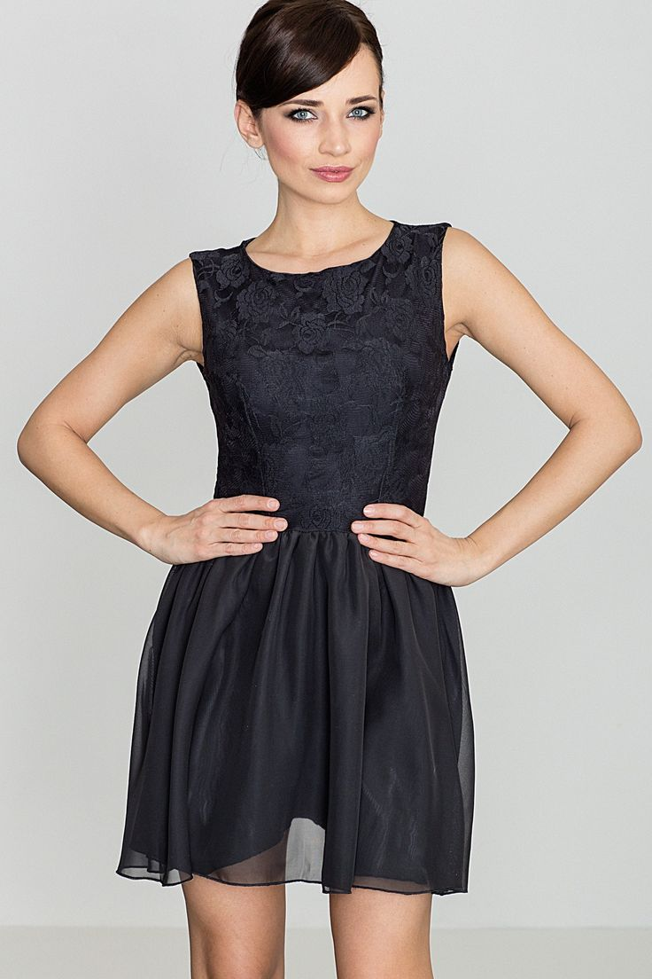 This black sleeveless mini dress is made of high-quality fabric with a comfortable lining. The dress has a tight but delicate guipure upper part and flowing bottom. The silhouette and combination of two fabrics make the dress look feminine and stylish.