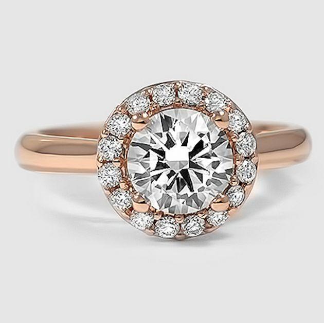 Pretty lil bobble. A brilliant halo diamond ring.
