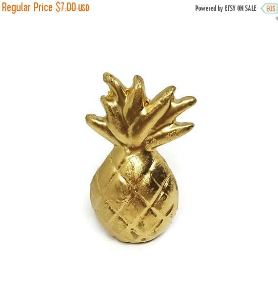 Tropical pineapple dresser drawer knobs for baby, kids, and adults alike! Available in two colors: whitewash and gold. Each knob measures about 1.25 x 2.2 x 1 inches and includes necessary mounting hardware. the bolt on this knob measures about 1.63 inches in length.  Ships within about 5 business days.