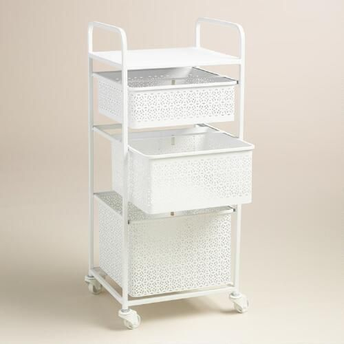 Lend a fresh look to the powder room or master bath with our white three-drawer cart, crafted of punched metal in a filigree design and fitted with castors that swivel and lock. For even more stylish storage, pair it with our coordinating Mia bins.