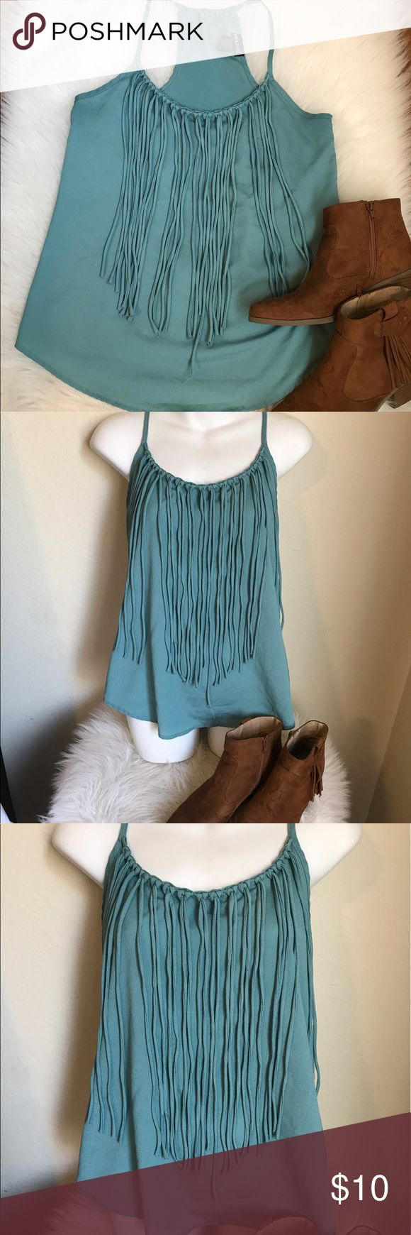 💐Lovely teal fringe racer back style top In excellent condition. Great go to relax wear. Very light fabric. Pair with jeans boot and denim jacket for a casual look or go with a black thick leggings with some pumps and accessories for a downtown chic look. 100% polyester Wet Seal Tops