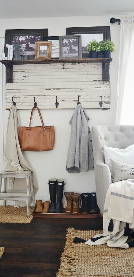 Give your entryway or living room a charming cottage feel by taking inspiration from this rustic home decor. We absolutely love the look of distressed beadboard coat hooks combined with antique picture frames—it's so unique!