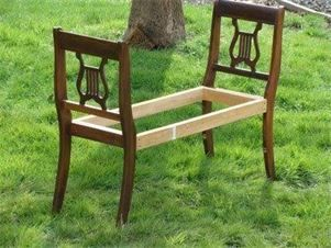 What a great idea... marrying two ornate chair backs together to make a bench.  Awesome!  You could simply make it a wooden bench with or without a cushion or you could upholster the seat.