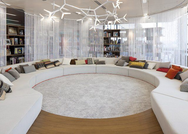 Fancy - Office Room Design: Exotic Office Lounge With Chic Round White Sofas And Rug With Plant Shape Chandelier