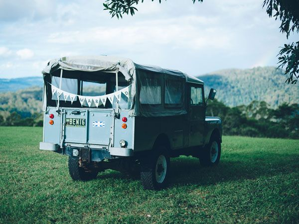 For as long as she can remember, bride Johsi's family has only ever owned Land Rovers. After her father passed, she held on to his last car. In honor of him, she featured a Land Rover as a prop in the pre-dinner drinks picnic area at her wedding.