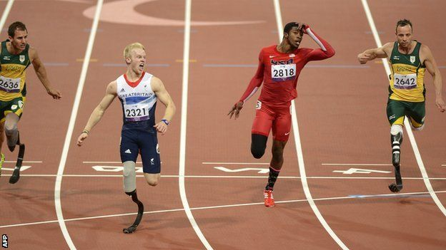 Jonnie Peacock wins gold, running the fastest T44 100m time in Paralympic Games history