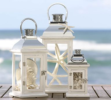 Lanterns filled with white finger starfish and seashells as featured in Pottery Barn. Find the shells and starfish at California Seashell Co.