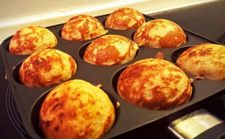 Danish æbleskiver (puff pancakes) on the pan.