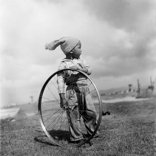 Young boy holding a wheel, District Six, Cape Town, South Africa