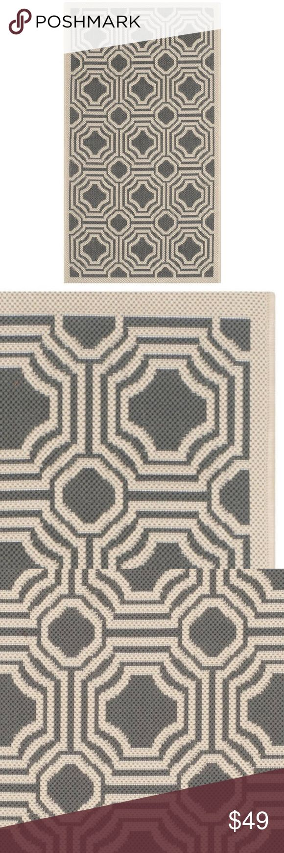 Indoor/ Outdoor Rug 2' x 3'7 Featuring a main accent color of anthracite, this rug is in vogue with its tasteful and bold modern design. A mesmerizing geometric pattern makes this rug a stand-out piece. Its arabesque design elements will work beautifully on a patio, as well as in a kitchen, eating area, or playroom. Suitable for indoor or outdoor settings. Power loomed weave. Pile height is 0.25 - 0.5 inch. Crafted of Polypropylene; latex fee. Contemporary style.  Rug Size: 2' x 3' 7.  NWT…