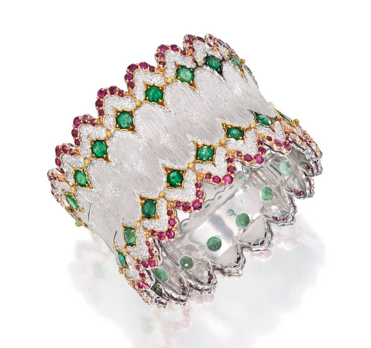 Lot 306 - 18 KARAT TWO-COLOR GOLD, EMERALD AND RUBY BANGLE-BRACELET, BUCCELLATI
