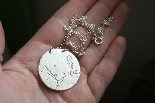 The Little Prince necklace. The main theme is the one of the Little Prince on his planet, from Saint Exupery.