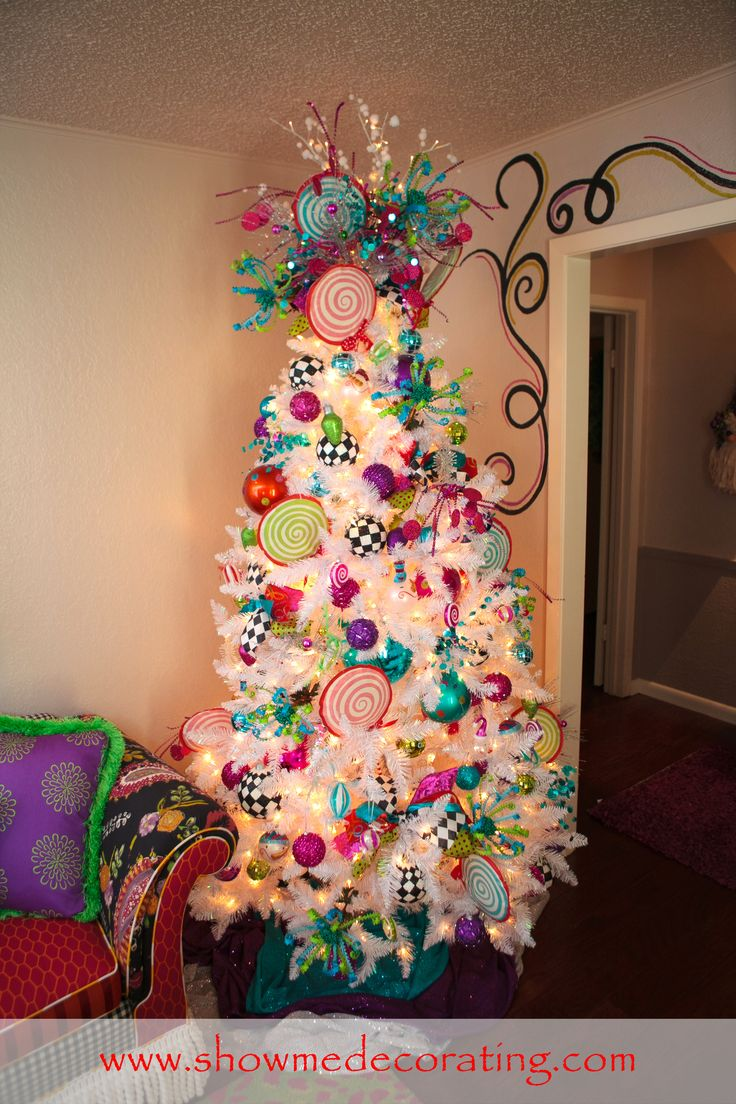 #WhiteChristmas #ChristmasTree Colorful ornaments and ribbon bring a touch of whimsy to this snow white Christmas tree