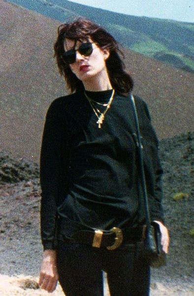 In the late 1980s, in Italy and most of western Europe, it was the fashion for teenage girls and young women to dress completely in black. Note the wide belt worn low at the hips