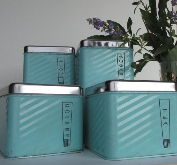 vintage kitchen decor  Robin's Egg Blue Canister Set by TheWillies, $45.00.  Since it wouldn't match my kitchen, I'd probably still use it for bathroom storage!  Even if they are labeled coffee, tea, flour, etc....