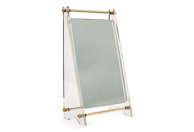 Midcentury tabletop mirror with a Lucite A-frame stand and rolled brass handle.
