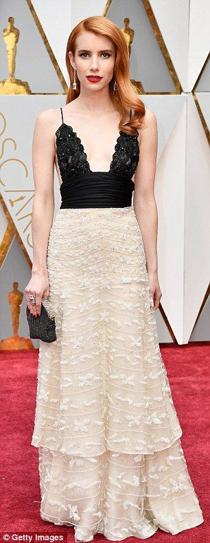Stunning: Michelle Williams (left) and Emma Roberts donned very similar dresses as they hi...