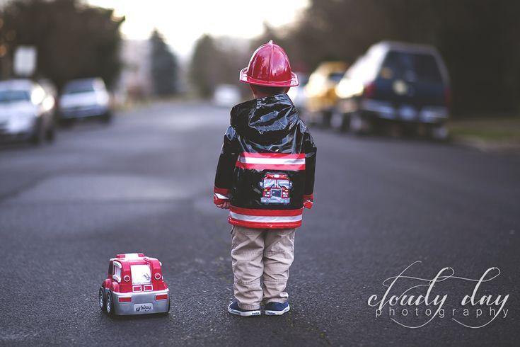 little fireman in his fireman rain jacket