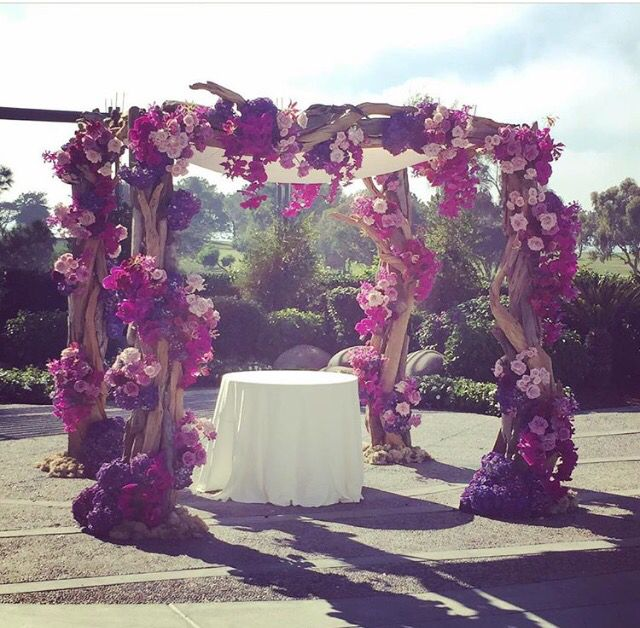 Glam and rustic purple and fuchsia Chuppah by Blush Botanicals