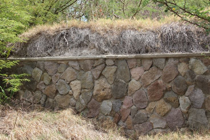 similar existing stone wall covered in ash)