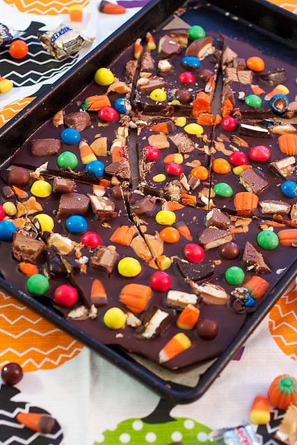 Halloween candy bark, perfect for leftover candy, easy and delicious! {Recipe by The girl in the little red kitchen}