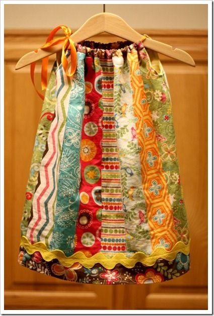 I love pillow case dresses to begin with...but using scraps...or maybe even upcycle some of dad's shirts...it's just too cute!!