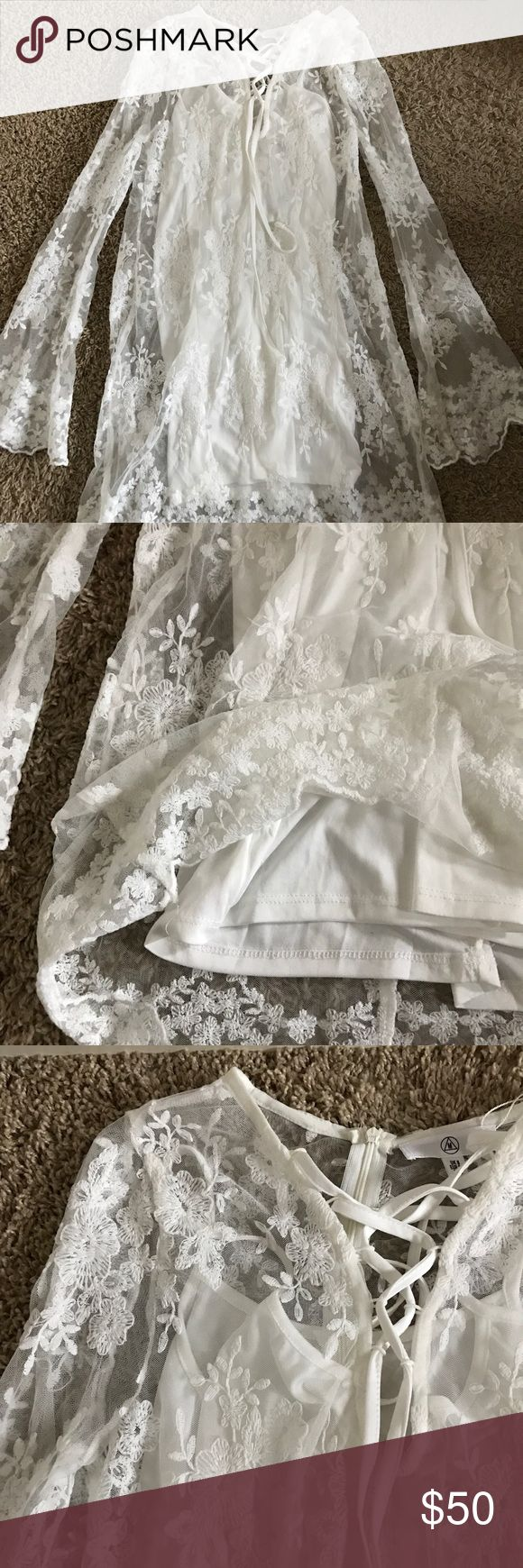 Missguided White Floral Dress -New with tags -See through top layer with another bottom layer -Floral pattern -Long sleeved and thigh length -Size 4 Missguided Dresses Long Sleeve
