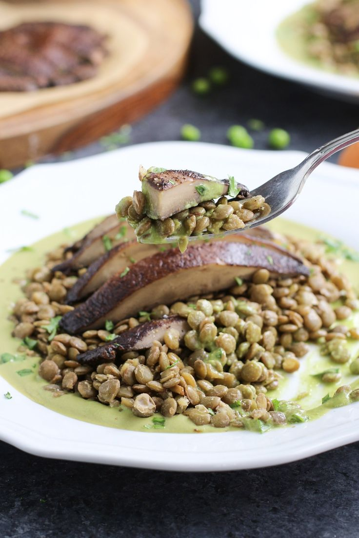 Tender slices of garlicky roasted portobello mushrooms and protein-packed lentils swimming in a flavorful green pea basil pesto sauce. Vegan.