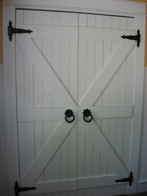 I want something like this (only not white and not so clunky for our pantry doors