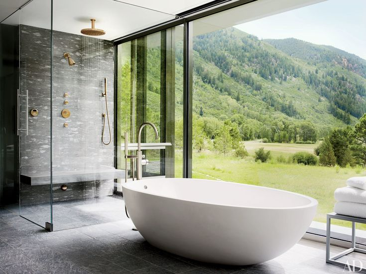 35 Stunning Shower Ideas from the Pages of AD Photos | Architectural Digest [In an Aspen, Colorado, home by Shelton, Mindel & Assoc., the master bath's shower and Agape tub are equipped with Dornbracht fittings.]