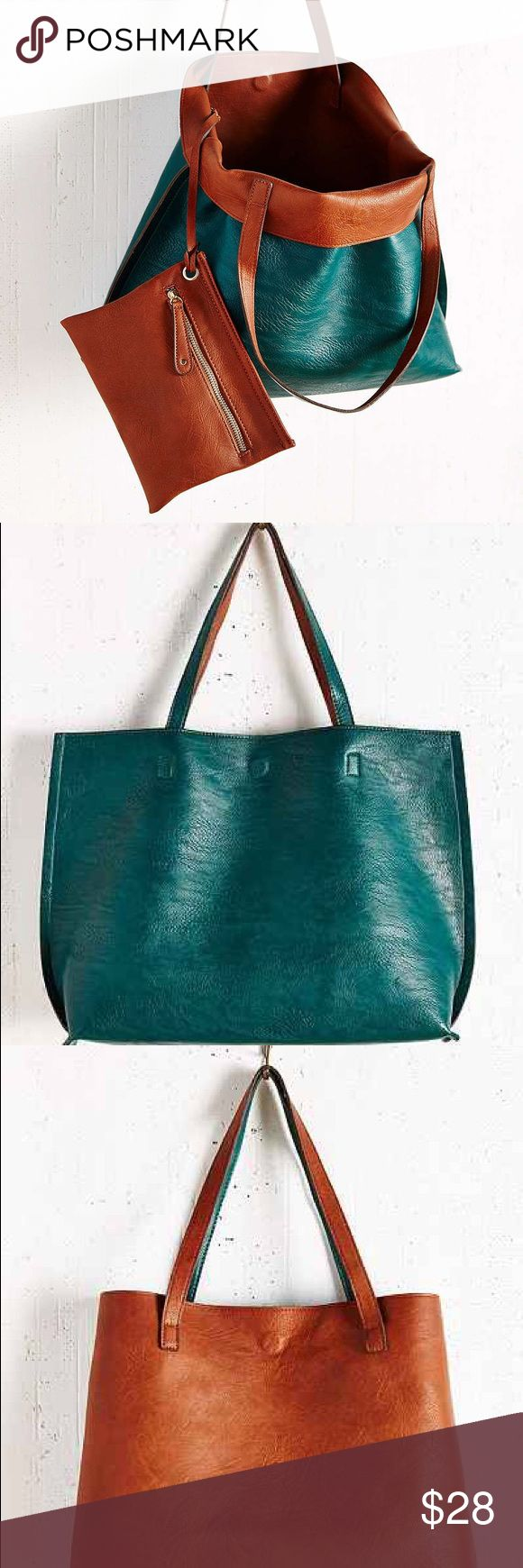 Reversible Urban Outfitters Tote Bag Reversible Urban Outfitters Vegan Leather Tote Bag in Pebbled Faux Leather. Colors Brown & Teal.   • Mix n match • Features hidden magnetic closure • Spot Clean Urban Outfitters Bags Totes