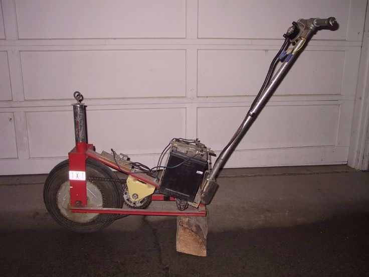 Motorized Trailer Dolly by Weldordie -- Homemade battery-powered trailer dolly constructed from a surplus winch motor, wheelbarrow wheels, and steel. http://www.homemadetools.net/homemade-motorized-trailer-dolly
