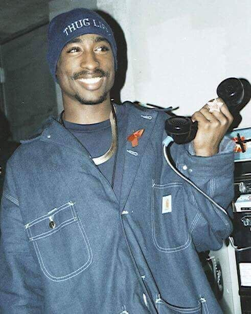 Tupac's smile lights up the room.