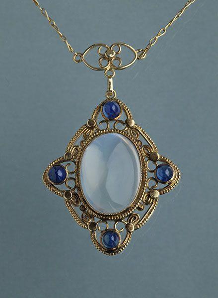 51 best moonstone pendants images on pinterest moonstone pendant art nouveau 18kt gold carved moonstone and demantoid garnet pendant jvthehungerga mozeypictures Images