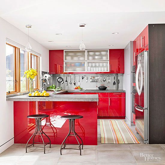 Glossy red cabinets capture a sleek modern look in a real-world budget in this red hot kitchen! Look here for more small kitchen makeover ideas: http://www.bhg.com/kitchen/small/small-kitchen-makeovers/?socsrc=bhgpin031215redhotkitchenmakeover&page=6
