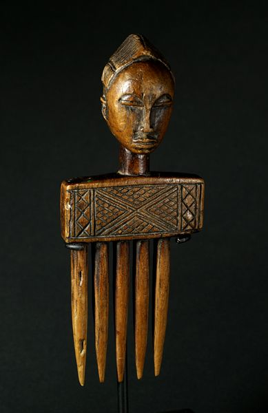 Baule comb with woman head, Ivory Coast