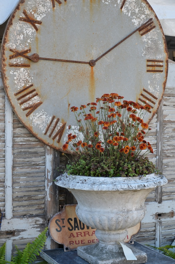 Vintage Chic... rusty clock...shabby & chipped shutters...aged urn with flowers.