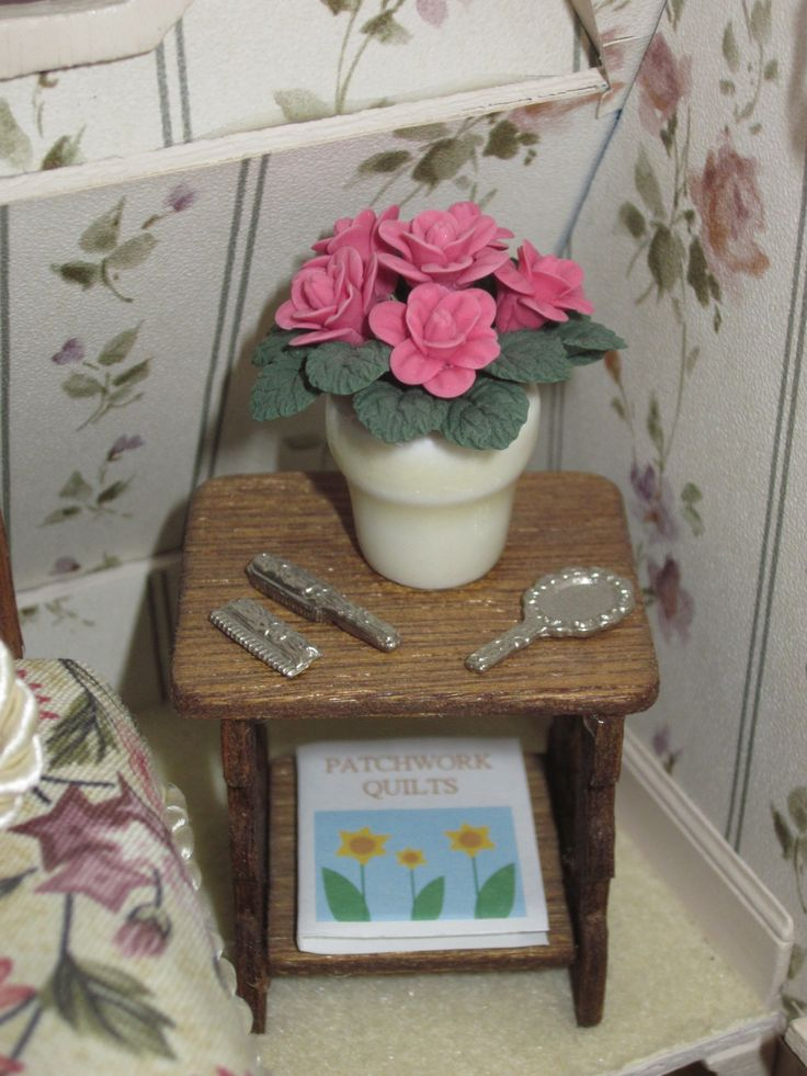 A close up view of the end table and its pink roses