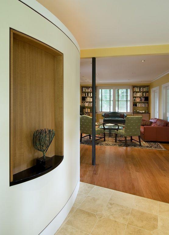 Contemporary Hallway with Built-in bookshelf, Columns, Concrete tile
