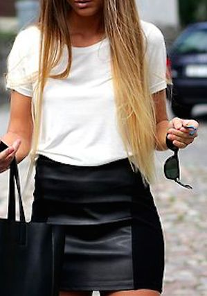 This outfit has all the seasons essential pieces.  White tee, leather skirt, tote all bag and fabulous hair.