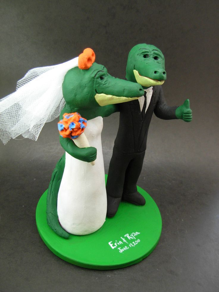 Custom made to order Florida Alligator college mascot wedding cake toppers. $235 www.magicmud.com 1 800 231 9814 magicmud@magicmud... blog.magicmud.com twitter.com/... $235 #mascot #collegemascot #hokie #ms.wuf #gators #virginiatech #football mascot #wedding #toppers #custom #Groom #bride #weddingcaketoppers #caketoppers www.facebook.com/... www.tumblr.com/... instagram.com/... magicmud.com/Wedding photos.htm