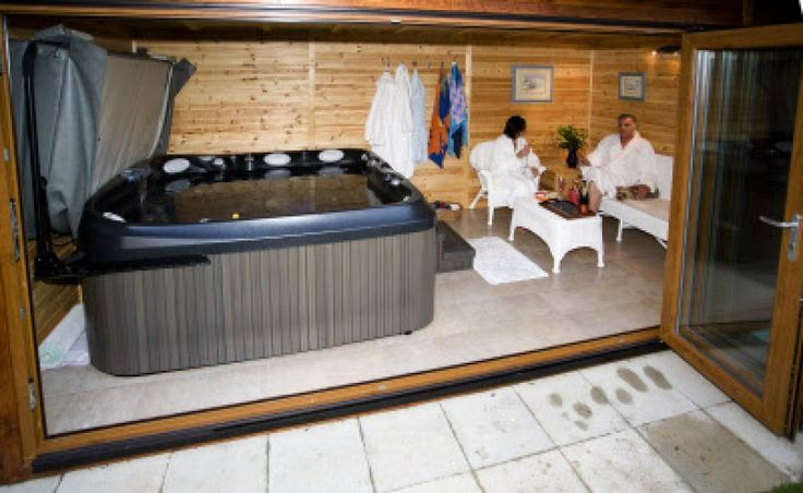 Jacuzzi in a wooden summer house   www.bakerstimber.co.uk
