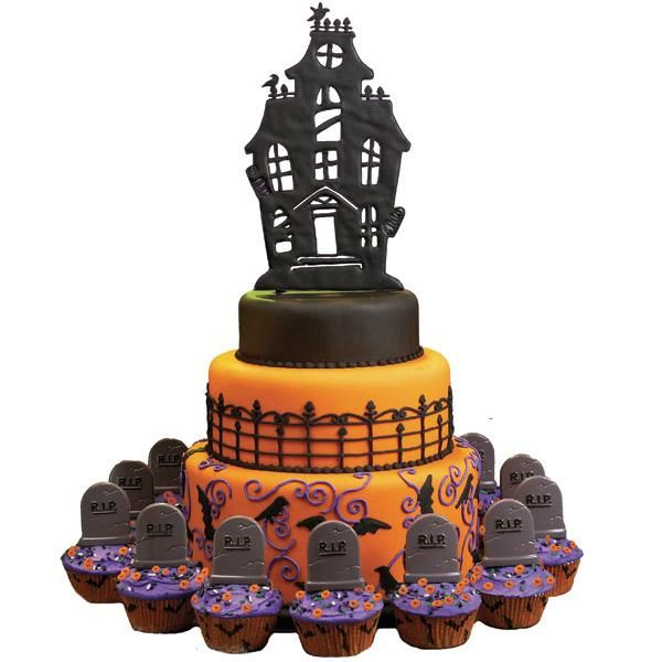 Halloween Haunted House Cake: I love how the gravestones on the cupcakes surround the house on the hill.