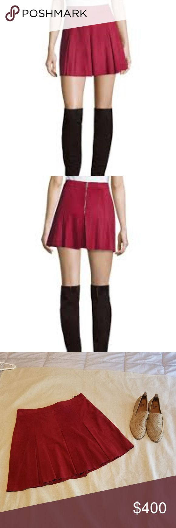 "Alice & Olivia Lee Red Pleated Suede Mini Skirt Topstitched pleats release kicky flare to an A-line mini cut from supersoft and supple goat suede.  Size: 8 Color: Bordeaux (Red/Burgundy)  Product Details: Rise sits just below the natural waist. A-line silhouette. Box pleats. Exposed back zip closure Stretch lining  Measurements: Approx. 16.5"" length (size 8)  Materials: 100% goat leather  Care: Professional leather clean Alice & Olivia Skirts Mini"