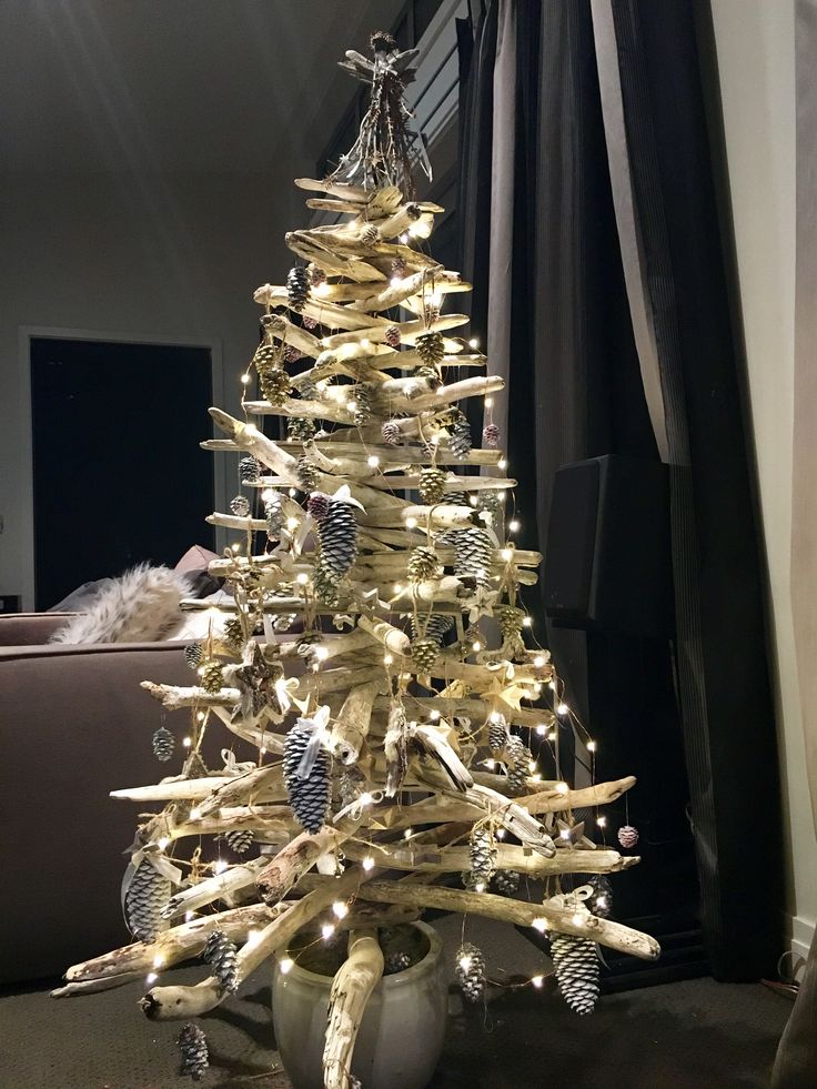 Drift wood Christmas tree with pine cone decorations