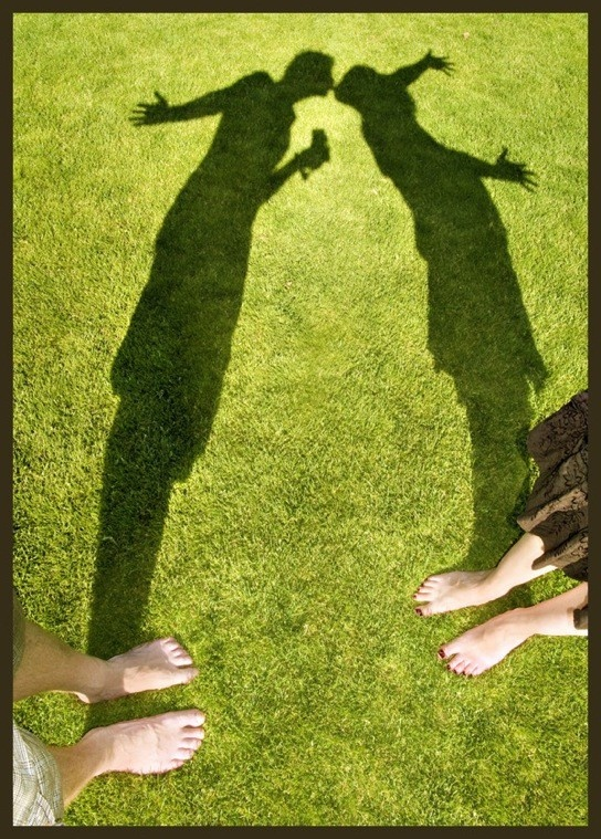 I love how the shadow says everything, and they would just be two people facing each other if the sun wasn't shining that way.