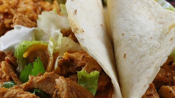 Slow-cooked chicken breasts need only chicken broth and taco seasoning to make a mean taco filling.