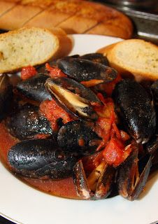 This version of Mussels Marinara was fresh and flavorful and only took a few minutes to make. The original recipe uses fresh mussels, which I couldn't get in my neck of the woods, so I just used two boxes of frozen, thawed mussels without the sauce packet.